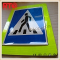 Prismatic reflective vinyl for road signs